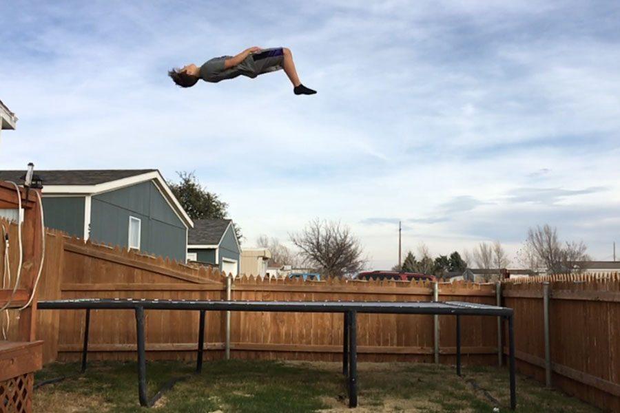 Sophomore Jayden Bilbrey performs a mid-air flip.