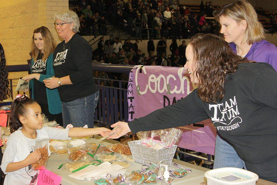 Math teachers Rebecca Polasek, Machelle Knoll, Kelli Mooring and Jessica Ray sell pastries at the Canyon versus Amarillo basketball game.