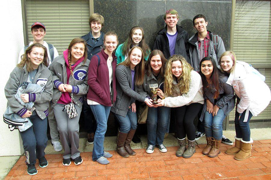 The journalism and ready writing teams celebrate after winning the Red Raider academics meet.