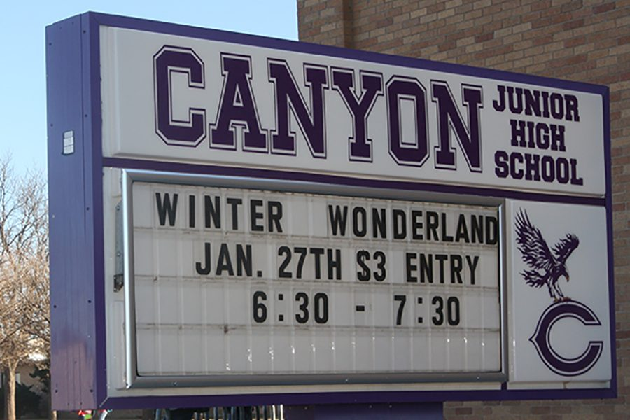 The sign in front of Canyon Junior High displays the information for the Winter Wonderland Carnival.