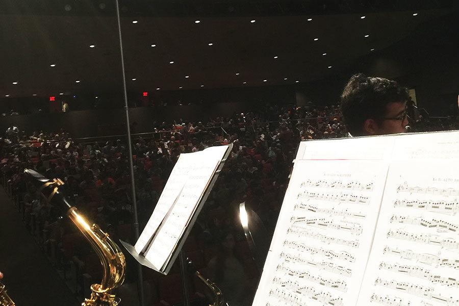 The 6A All-State Band prepares to perform in Lila Cockrell Theater.