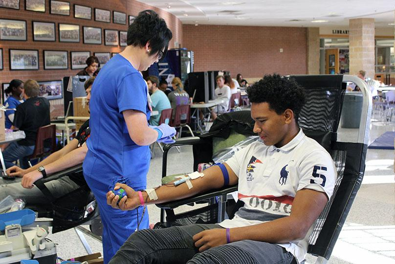Freshman Andre Driskell has blood drawn at the fall blood drive.