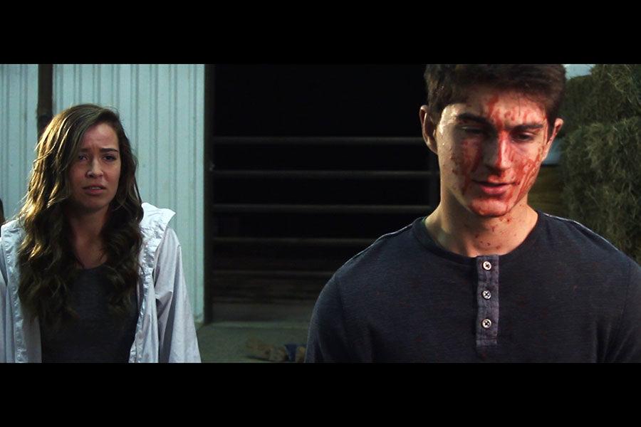 Logan Giles and Sarah Gilliland film a scene for