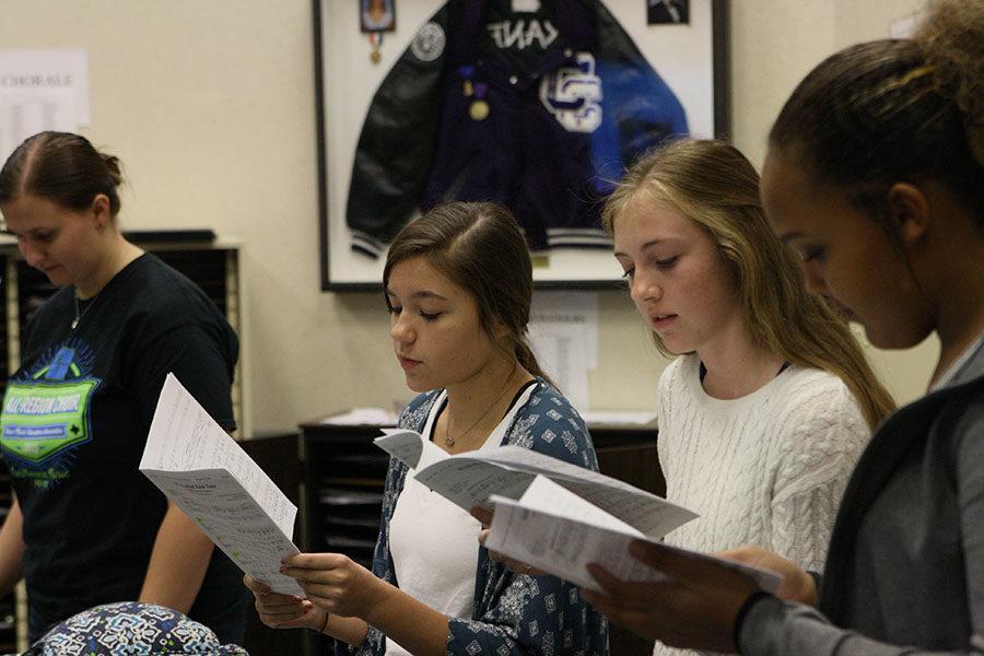 Senior Callie Boren, freshman Mia Bonds, sophomore Emma Sheets and sophomore Kaleigh Rodarte-Suto rehearse choral pieces during an activity period practice.
