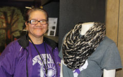 Martha Varela displays one of her handmade scarves on a mannequin in The Eagle's Nest.