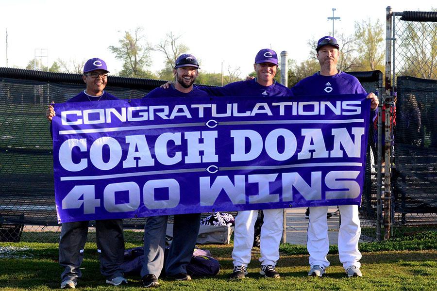 Baseball coaches Ernest Trejo, Jared Peddy, John Doan and Wade Williams celebrate Doan's 400th win.
