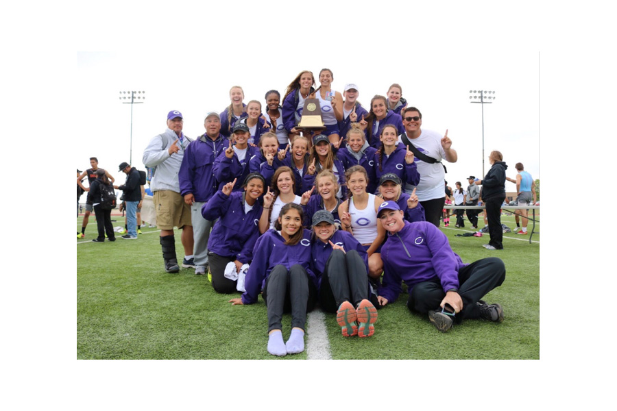 The Lady Eagle track team celebrates after the area track meet.