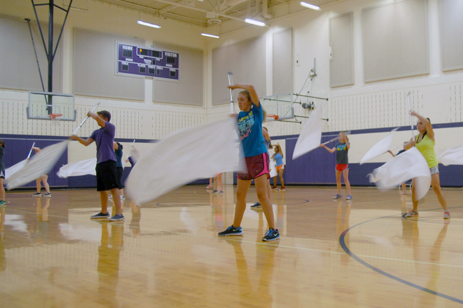 The bands color guard rehearses for their marching show, Uprising.
