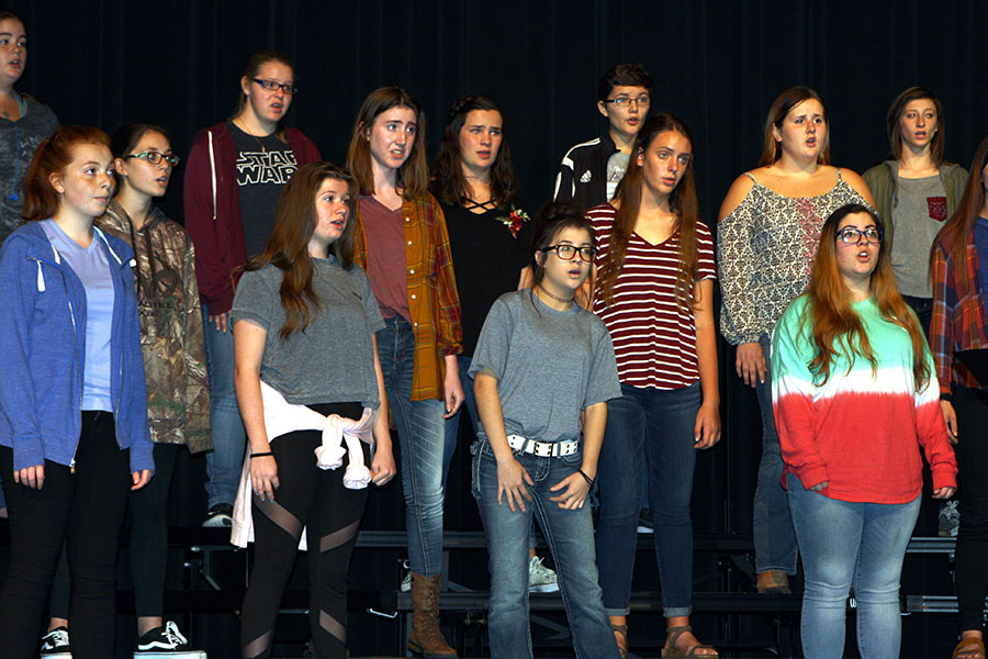 The chorale practices onstage for its concert.