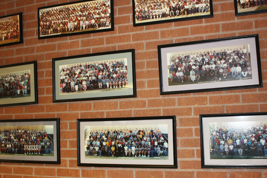 Previous senior photos are on display in the commons.