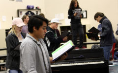 Juniors Nolan Quintanilla and Katelyn Spivey join other choir members practicing audition music  during activity period.