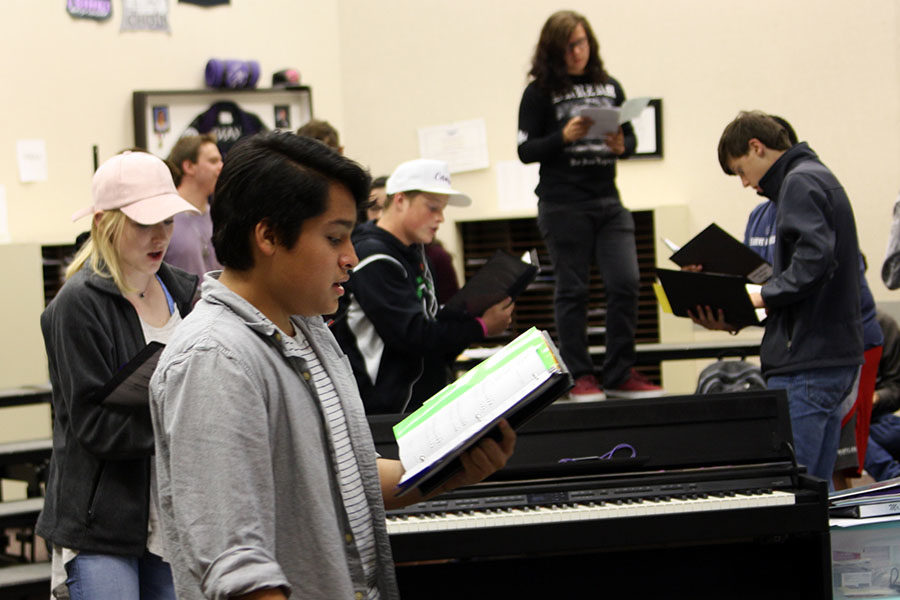 Juniors+Nolan+Quintanilla+and+Katelyn+Spivey+join+other+choir+members+practicing+audition+music++during+activity+period.