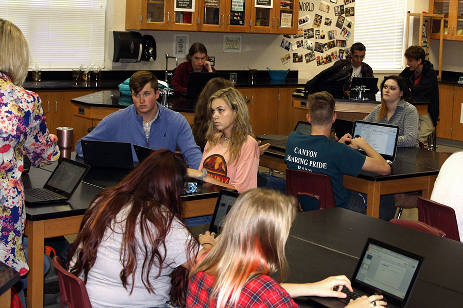 Science students work on Chromebooks in Cortney Shallers forensics class.