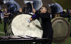 Sophomore Cambry King plays bass drum during the ballad of the bands performance at the football game against Palo Duro.
