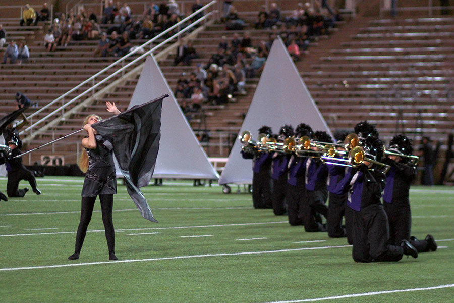 The Soaring Pride performed the first movement of their show, Uprising, at the football game against Amarillo High.