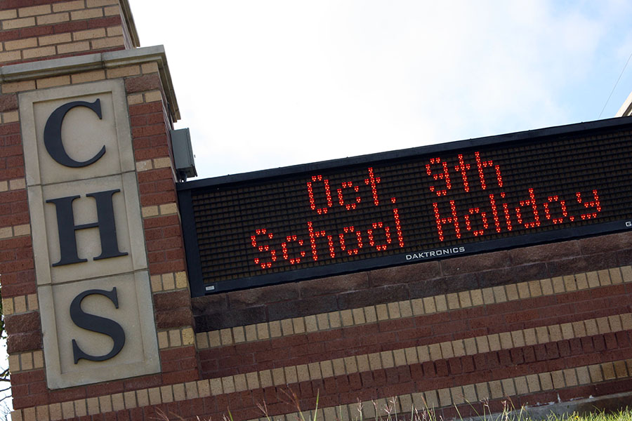 The sign in front of the high school reminds students of the Oct. 9 school holiday. Students are also off from school Oct. 5-6.