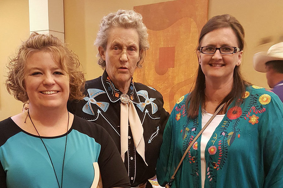Teachers Bree Holbrook and Anne Skalsky meet Dr. Temple Grandin at an autism convention in Albuquerque, New Mexico.