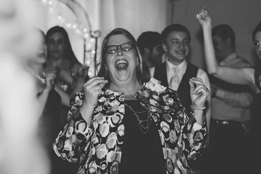 Debbie Crenshaw celebrates at her older daughter's wedding reception.
