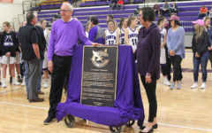 Coach Joe Lombard and his wife Babs celebrate with the plaque for the foyer.