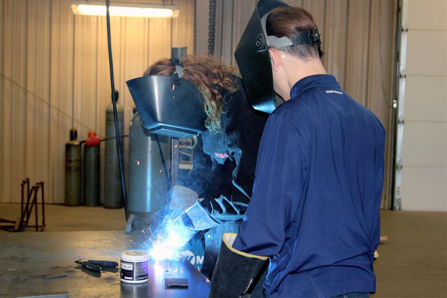 Sophomores Cade Rhodes and Roy Short weld together.