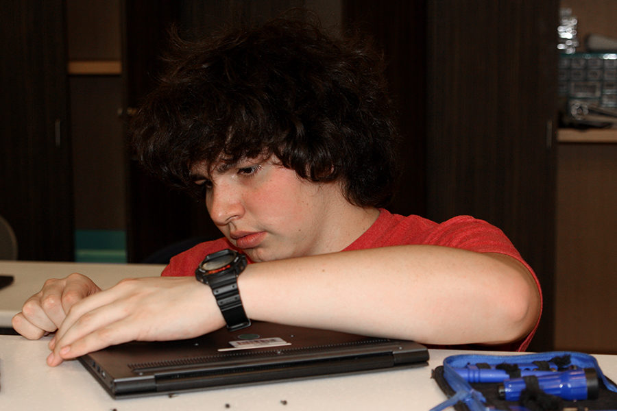 Junior Jonah Ramirez works with a Chromebook in the iConnect center.