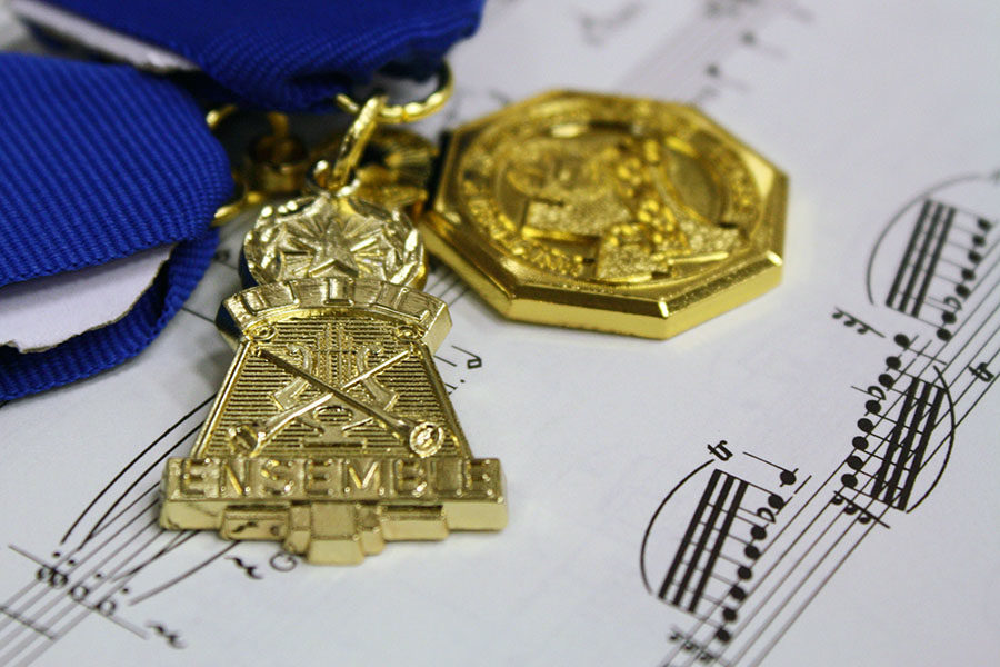 Students+who+earn+a+first+division+rating+receive+medals+for+their+achievement.