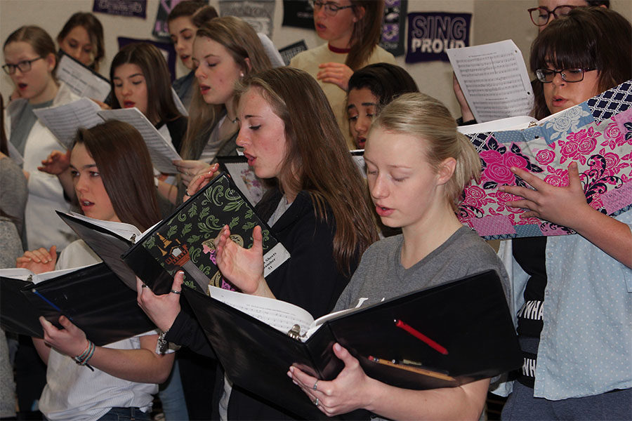 Choir students practice sight reading during a class rehearsal.
