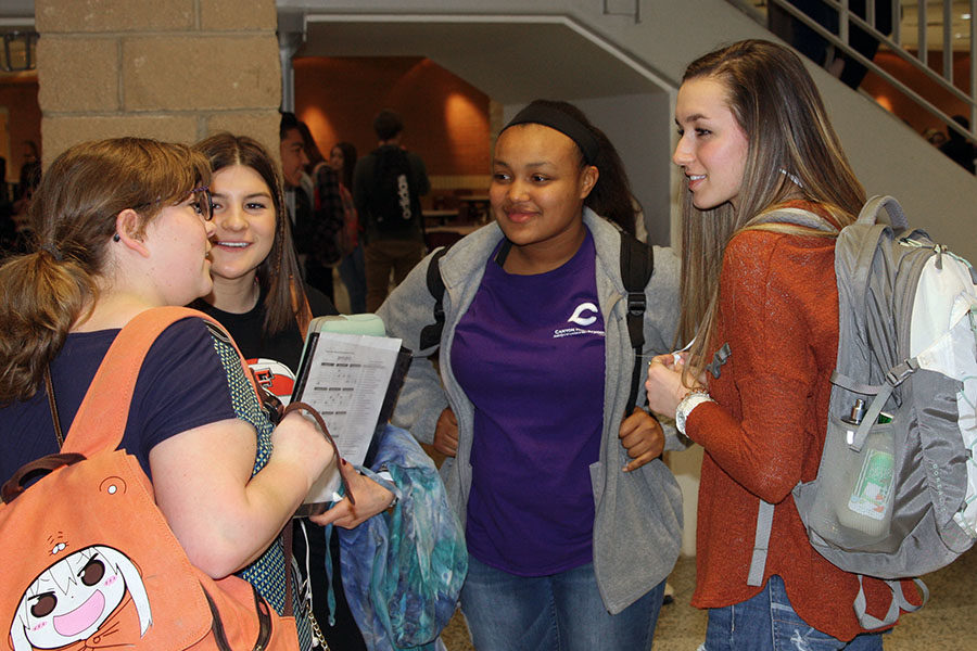 Freshman Maggie Parkhurst visits with sophomores McKenna Coppock, Marissa Spencer and Keelie Mitchell during a passing period.