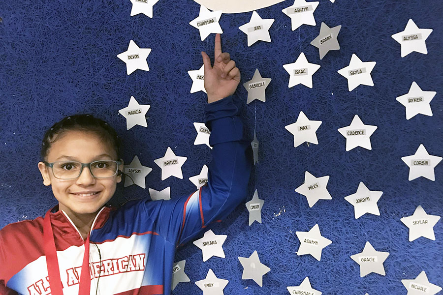 Christina Rodriguez stands beneath All-American Moon at a state competition.