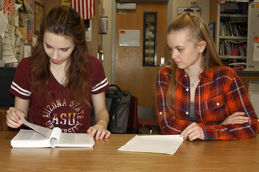 Senior Erin Sheffield and sophomore Macy McClish review an entry in the AP Stylebook as they prepare for the State UIL Academic Meet.