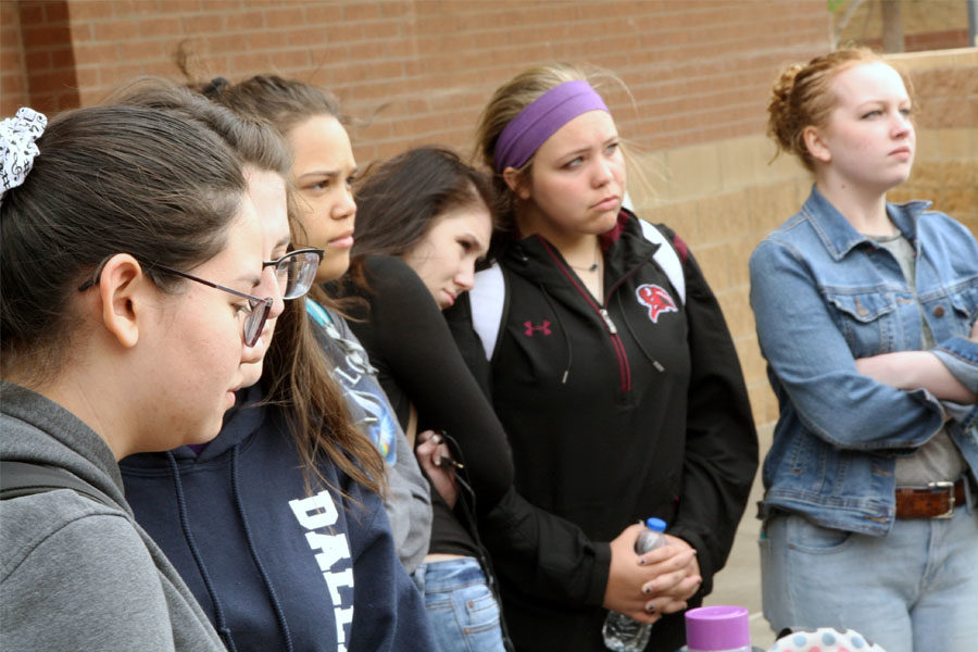 Students listen to speakers read the names of the Columbine and Parkland victims.