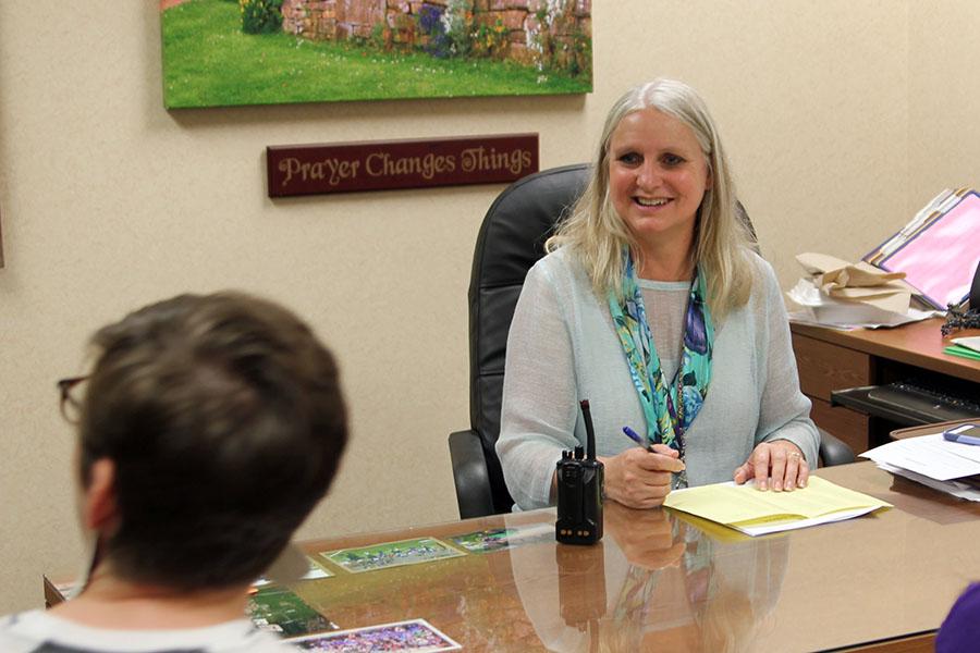 Associate Principal Jennifer Boren plans with 504 clerk Catherine Enns.