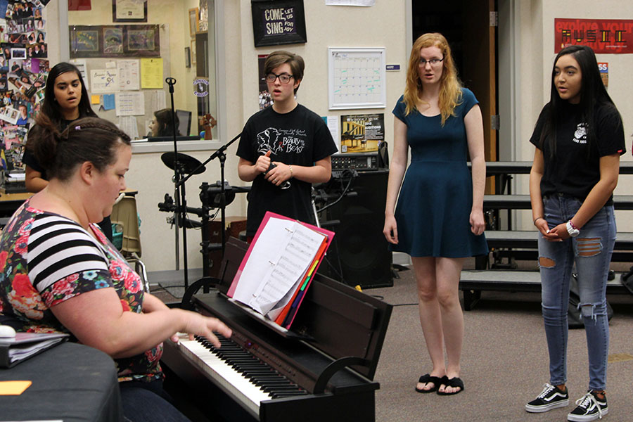Senior girls from the varsity choir rehearse for the Variety Show.