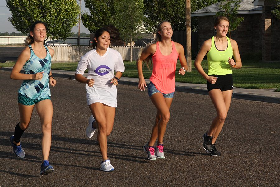 Juniors Jaden Boling and Kameron Diaz and seniors Kelsee Dudley and Caitlynne Speegle run during a cross country practice.