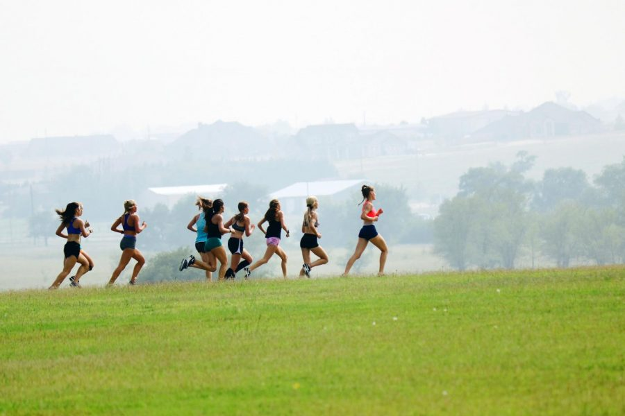 The+girls+cross+country+runs+through+the+area+behind+Canyon+High+School+during+a+recent+workout.