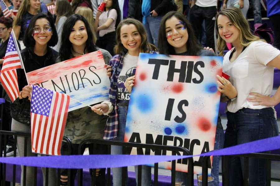 Seniors Ali Dominguez, Hailee Bookout, Jacy Hawkins, Kendall Carnahan and Amber Elbel display homemade patrotic signs at the Sept. 7 pep rally.   9/11 is a sorrowful event, but we won that, Bookout said. This is our country, and no one can tear us down. Our country can come back from anything.