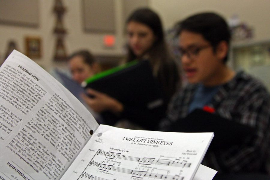 Chamber choir members Krissy Niles, Tori Ross and Nolan Quintanilla review