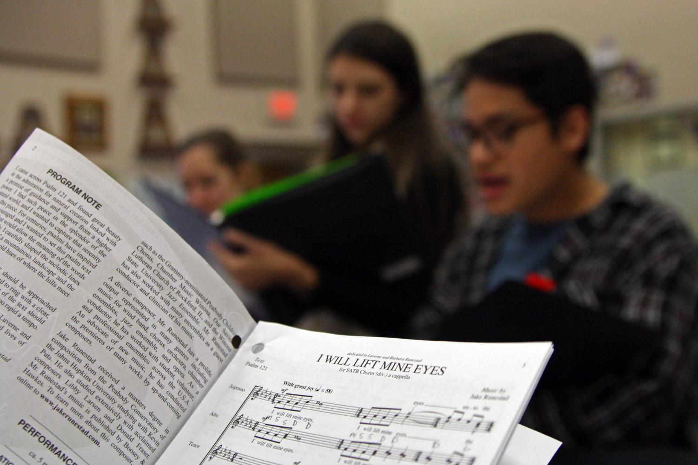 Chamber choir members Krissy Niles, Tori Ross and Nolan Quintanilla review