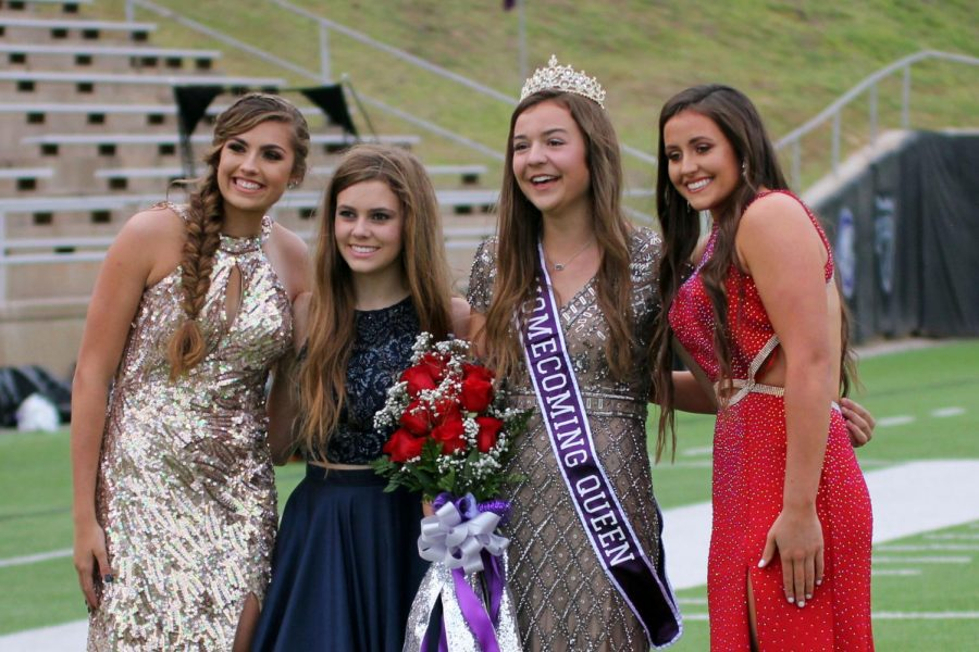 Finalists Brylee Winfrey and Emily Thurman join homecoming queen Maggie Bell and finalist Candain Callahan on the field at Kimbrough Memorial Stadium just after Bell was crowned queen before the football game.