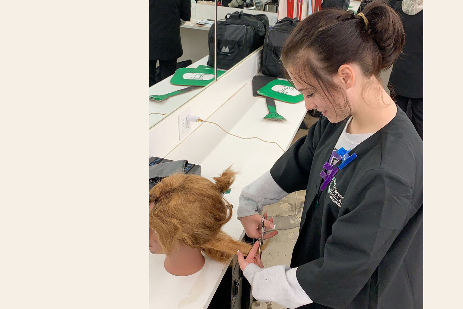 Junior Amanda Roberts works in her cosmetology class.