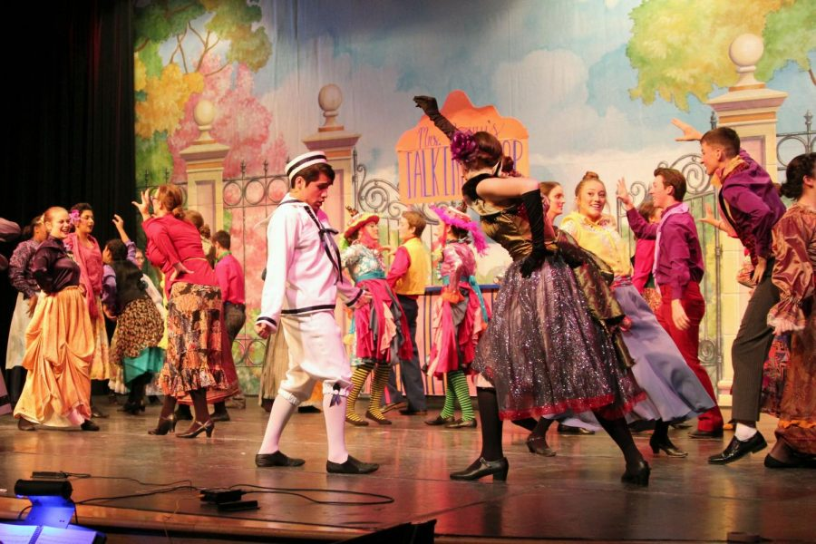 Michael Banks (Nolan Quintanilla) and Mrs. Corry (Erin Sheffield) dance with the customers of her talking shop during
