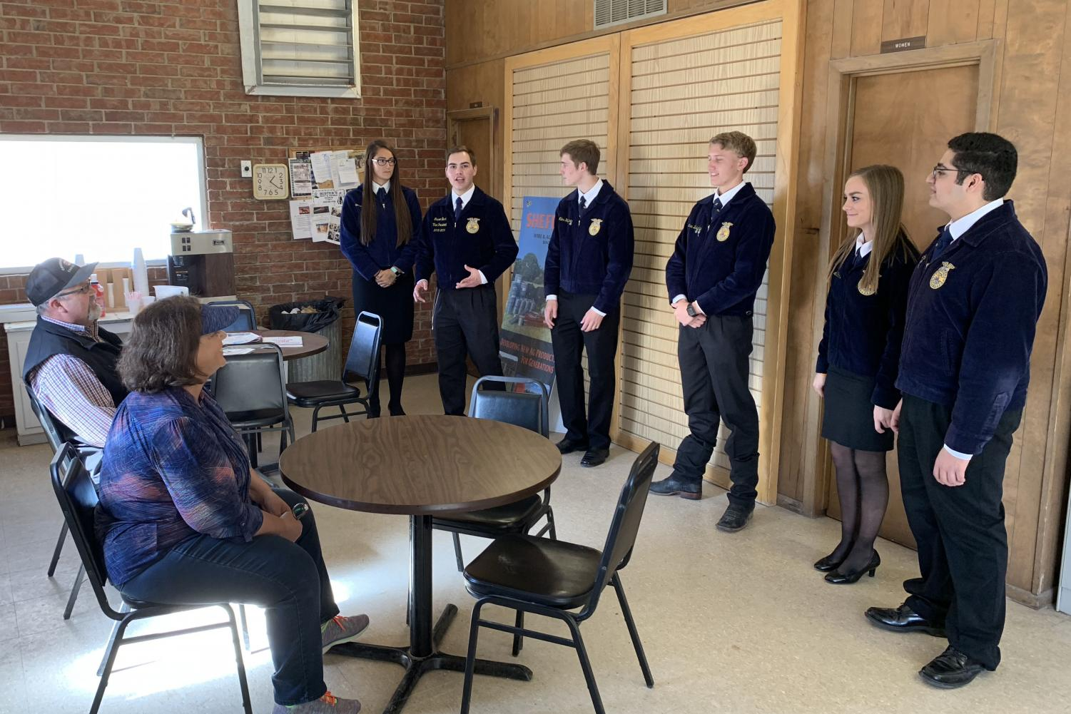 Sophomore Karstyn Salazar, senior Grason Bush, juniors Miles Huffhines, Lucas Bradshaw and Addie Hicks and senior Amadeo Loya practice their Ag Issues presentation at the Canyon Co-op in November.