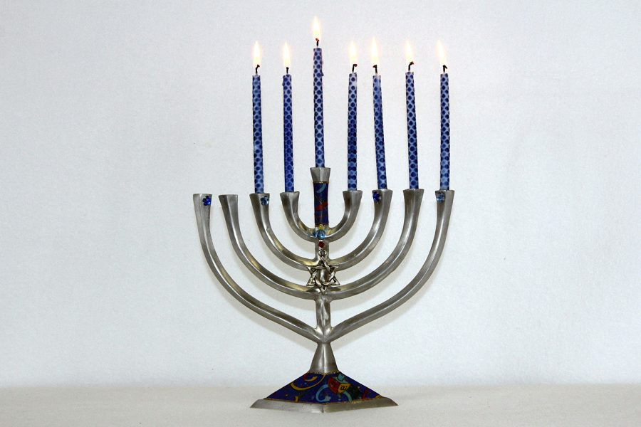 Families+celebrate+by+lighting+candles+on+a+menorah+throughout+Hanukkah.