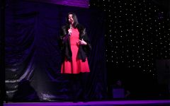 """Junior Mia Bonds presents her ticket home during """"Not for the Life of Me"""" from """"Thoroughly Modern Millie."""""""