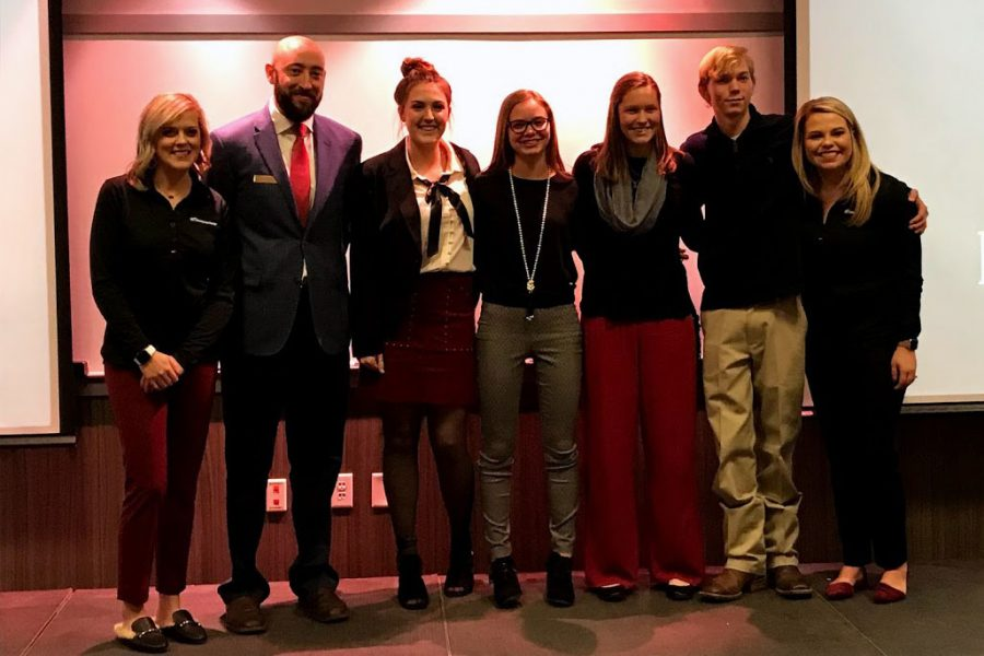 Tellerators+team+members+Brayleigh+Leach%2C+Aubyn+Nall%2C+Kelsey+Braudt+and+Brode+Boehning+stand+between+Kyla+Frye%2C+Rian+Clinton+and+Brittny+Lee+to+accept+their+awards.+