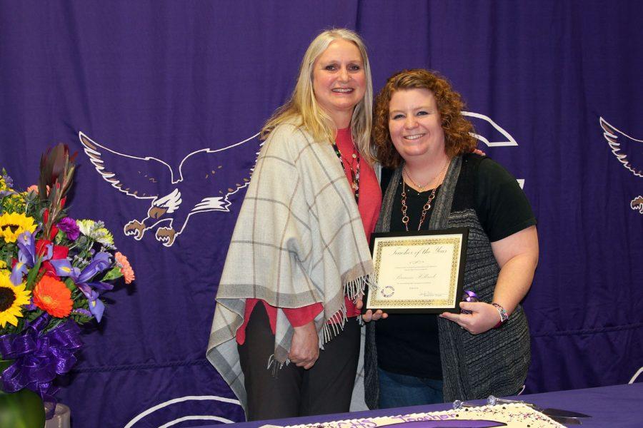 Principal Jennifer Boren presents the Teacher of the Year certificate to special education teacher Breanne Holbrook.