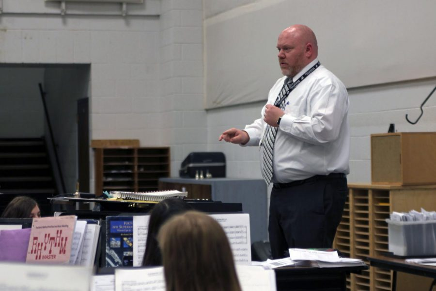Canyon Junior High band director Eric Rath conducts the junior high honors band.