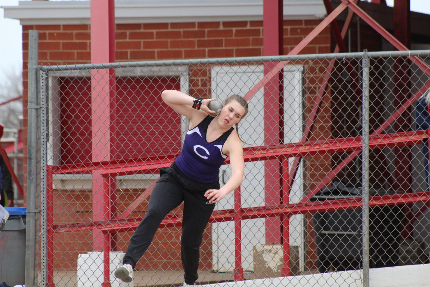Audrey Hughes throws the shot put at the Plainview track and field meet.