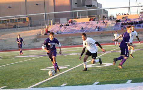 Varsity boys soccer end season as district champions