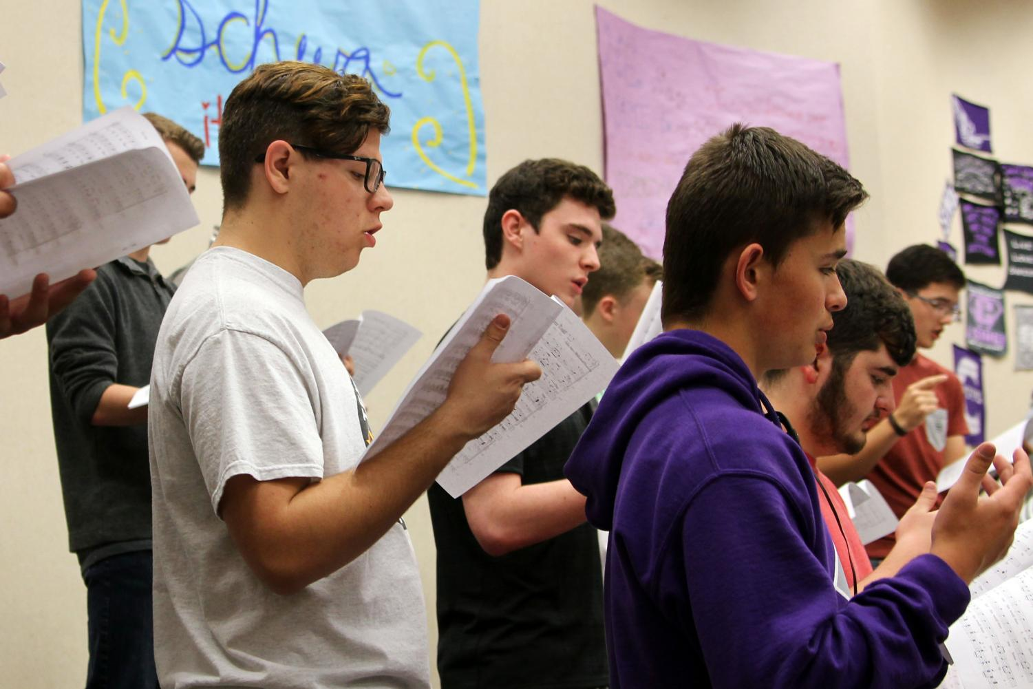 Sophomore Brennen Copeland rehearses with the men's choir. Copeland will perform in both the band and choir concerts.